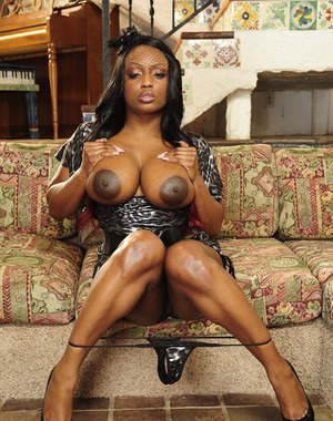 Ebony fatty MILF with big tits Roxanne Hall stripping and posing nude