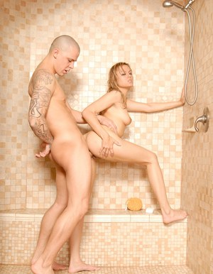 Hot babe with shaved pussy Angelina Armani gets fucked in the shower