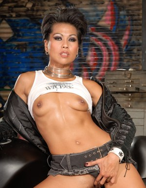 Asian MILF in mini skirt showing her tiny tits and spreading her legs
