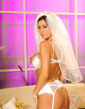 MILF babe Dylan Ryder poses solo in sexy brides dress and stockings