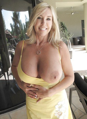 Mature blonde wife with huge tits shows off her gorgeous body outdoor