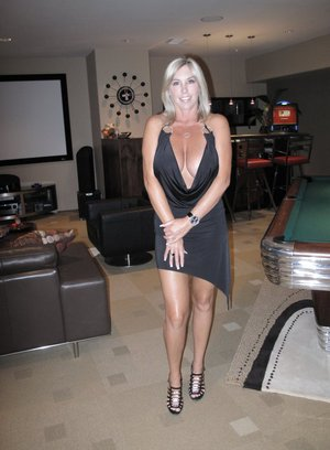 Stunning wife takes off her black dress to spread her legs