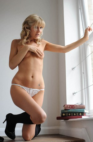 Blond school girl Holly Newberry strips and shows sexy legs in socks