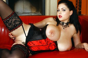 Big titted MILF Shione flaunting in erotic lingerie and stockings