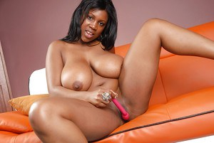Black MILF with enormous breasts Maseratti gets off with a sex toy