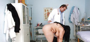 Chubby mature with her legs spread wide at the gyno until she squirts