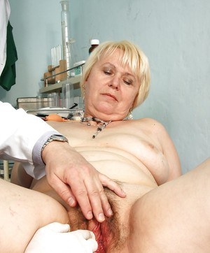 Nasty chubby granny gets her hairy cunt spread wide at the gyno