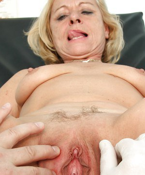 Mature lady in a perverted OBGYN visit with her wet pussy spread wide