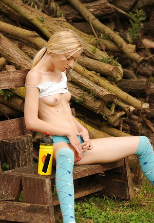 Outdoors in knee high socks, teen Diana P fucking herself to orgasm