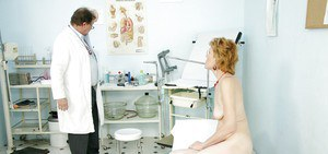 Granny in Glasses strips her ass for a perverted pussy exam by the Doc