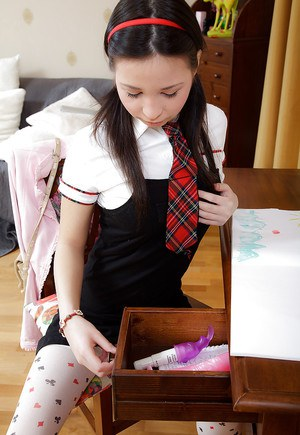 Young babe in school uniform Mandy L toying her sweet tiny pussy