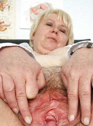 Chubby mature nurse spreading her legs and masturbating her fat cunt