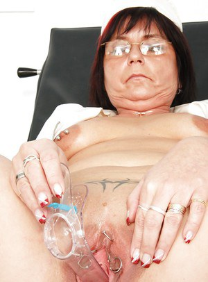 Nasty granny in glasses masturbating her muff and pissing