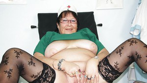 Horny granny playing with her huge flabby tits and toying her shaved cunt
