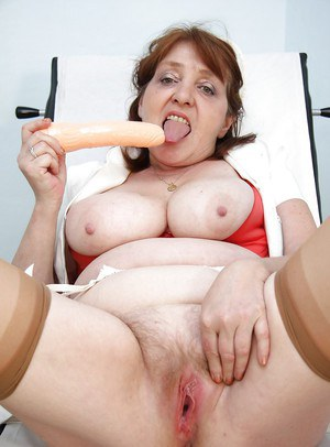 Redhead granny licking her flabby tits and playing with a big toy