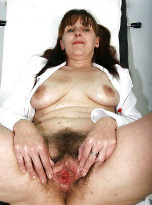 Horny aged nurse stretching her old hairy cunt with a gyno tool