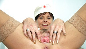 Stunning aged nurse in uniform and boots showing her hairy pink hole