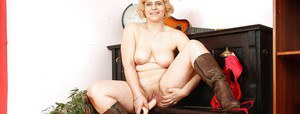 Chubby granny with flabby tits masturbating her twat with a toy