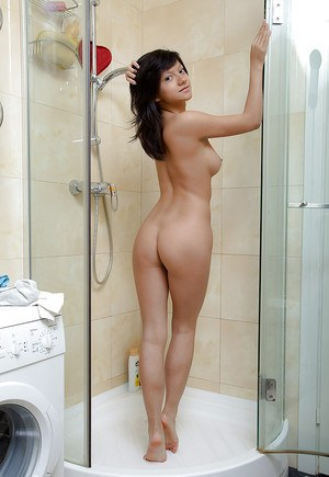 Filthy babe with tiny tits Alexis C riding a big dildo in the shower