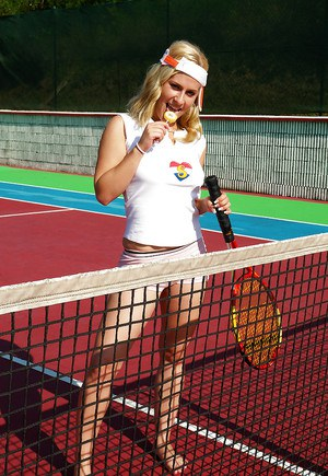 Sporty babe with big tits Angel B toying her cunt on the tennis court