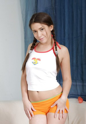 Lusty babe with pigtails Lara F enjoys a huge dildo in her pink hole