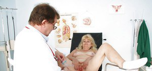 Mature blonde spreading her legs and pussy in the gyno chair