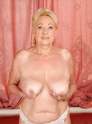 Fatty granny with flabby boobs and ample ass taking off her clothes