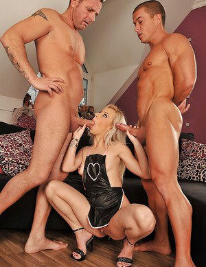 Horny blonde babe Chocky White is into wild groupsex with two guys