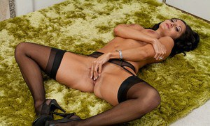 Seductive busty MILF on high heels Ava Addams taking off her clothes