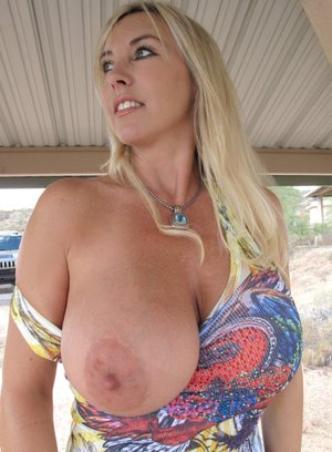 Stunning MILF with big tits and slender legs Wifey stripping outdoor