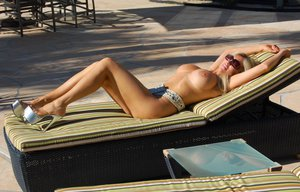 Blonde mature lady in sun glasses Wifey posing naked by the pool