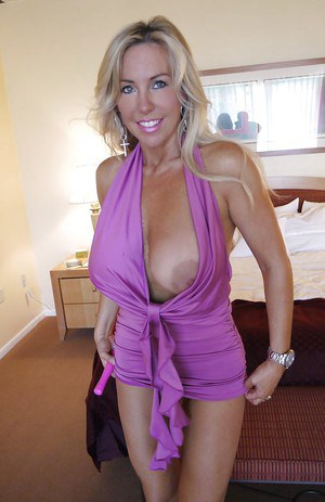 Blonde busty MILF on high heels Wifey posing and fingering her pussy