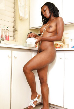 Amateur ebony babe Renee exposing her big jugs and hairy muff