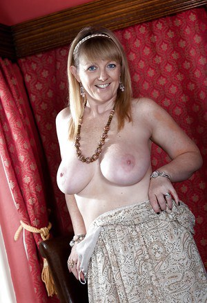 Sexy mature lady with huge boobs Sophie UK taking off her clothes