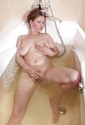 Busty MILF with hairy twat Chrysty stripping and taking bath