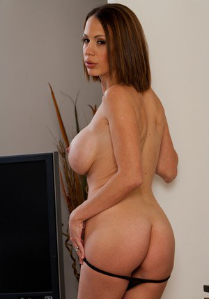 Smoking hot MILF McKenzie Lee taking off all of her clothes