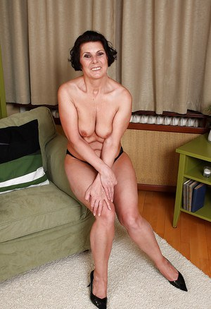Slutty granny on high heels Erin Eden taking off all of her clothes