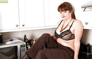 Fatty mature woman Suzzanne stripping and fingering her hairy cunt