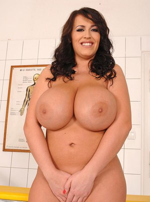 Hot babe with huge knockers Leanne Crow taking off her nurse uniform
