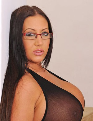 Curvy babe in glasses Emma Butt exposing her giant boobs with hard nipples