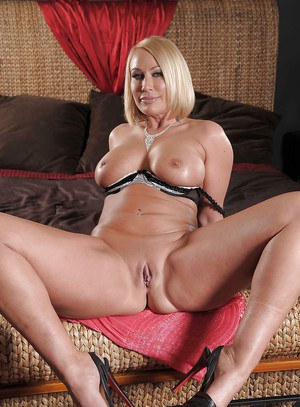 Blonde busty MILF Mellanie Monroe stripping and fingering her shaved cunt