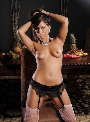 Gorgeous MILF in lingerie and stockings Reena Sky posing and stripping