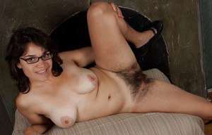 Fatty babe in glasses Hickory exposing her hairy armpits and shaggy cunt