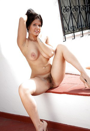 Sexy babe Kandie Luv stripping and spreading her legs outdoor