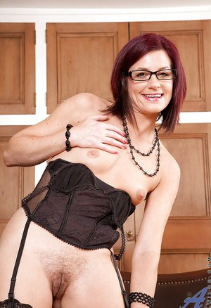 Seductive mature babe in glasses Sophia M posing and stripping