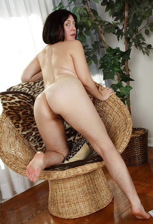 Busty woman with hairy armpits and legs Raven exposing her shaggy muff