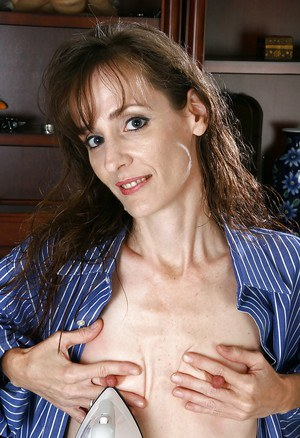 Skinny MILF exposing her tiny tits and spreading her slender legs