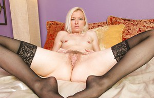 Hot babe in black stockings exposing her petite ass and hairy muff