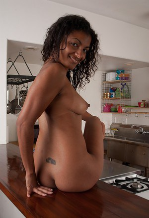 Tempting ebony babe Neela Sky stripping and posing in the kitchen