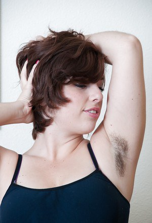 Pretty chubby babe exposing her hairy armpits and spreading her legs